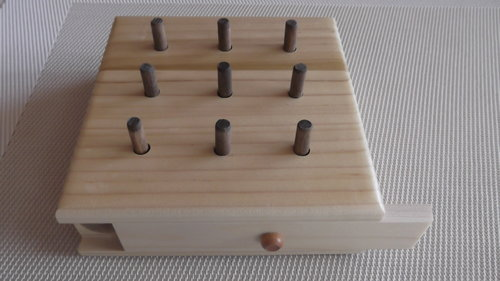 Nine hole peg set